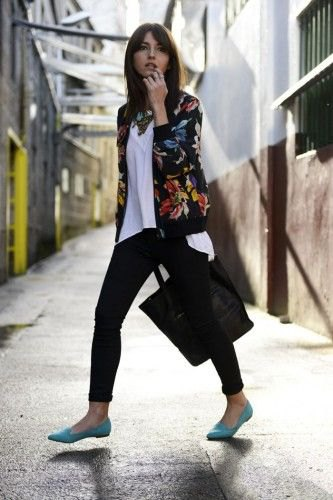 black floral bomber jacket with white linen top and skinny jeans