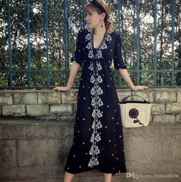 black midi dress with flower button in front