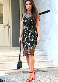 black knee-length skirt with floral embroidery and matching top