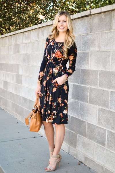 black floral midi sheath dress with a gathered waist