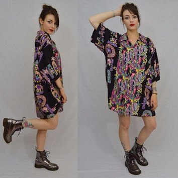 black aloha shirt dress with floral pattern and ankle boots