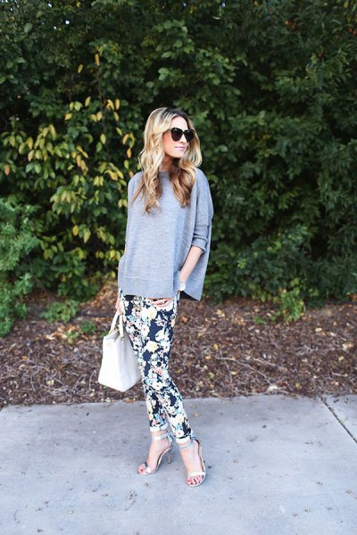 black, floral printed trouser sweater with batwing sleeves