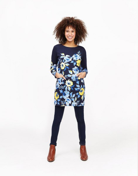 black tunic blouse with floral pattern and brown boots