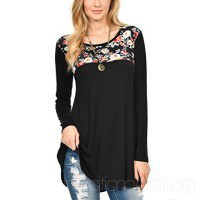 black tunic top with floral pattern and ribbed skinny jeans