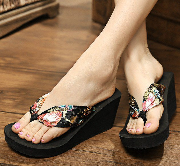 black wedge flip-flops with a floral pattern and white mini shift dress