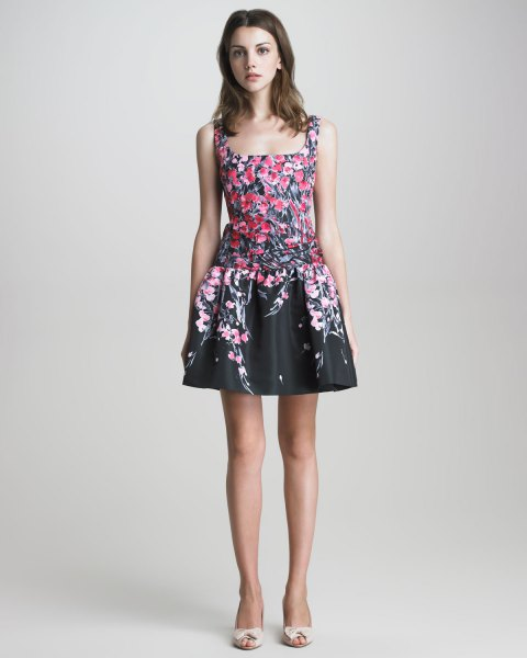 black mini skater dress with square neckline and floral pattern