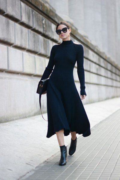 black, figure-hugging midi dress with ankle boots