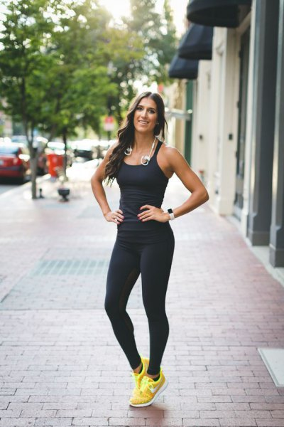 black figure-hugging vest top with running pants