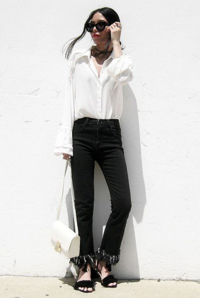black jeans with fringed hem and white shirt with bell sleeves
