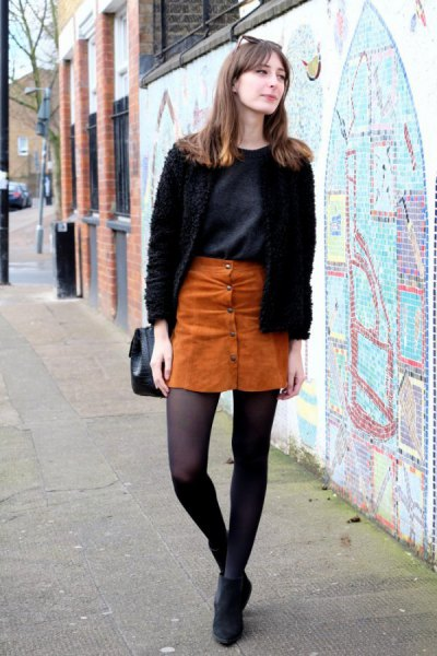 black fuzzy cardigan with suede mini skirt