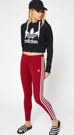black graphic cropped hoodie with baseball cap and red and white striped leggings