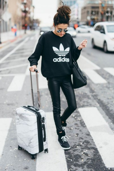 black graphic sweatshirt with leather gaiters and pullovers
