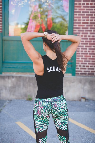 black graphic tank top with floral print workout leggings