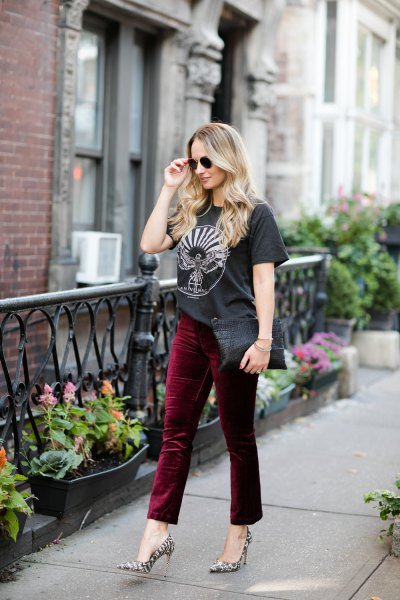 black graphic t-shirt with burgundy red velvet pants