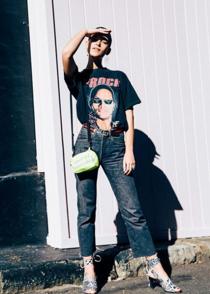 black graphic t-shirt with high waisted gray straight leg jeans