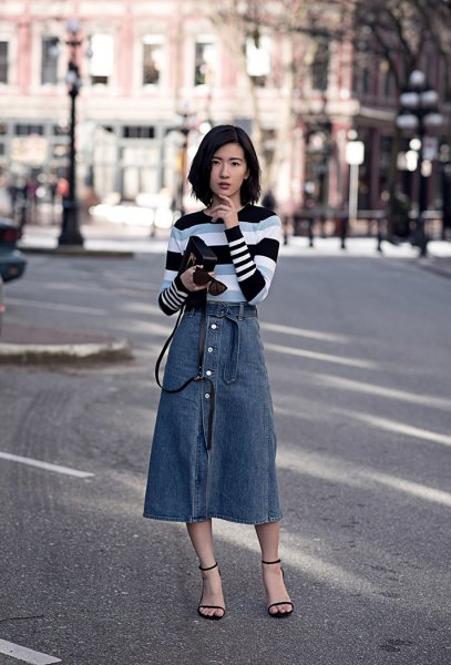 black gray and white striped sweater with blue midi button on the front of the skirt