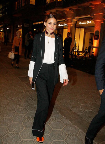 black half-sleeve blazer with white blouse and trousers with wide legs