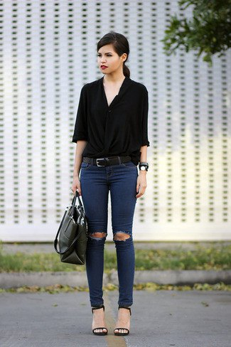 black button-down shirt with half sleeves and ripped dark blue skinny jeans