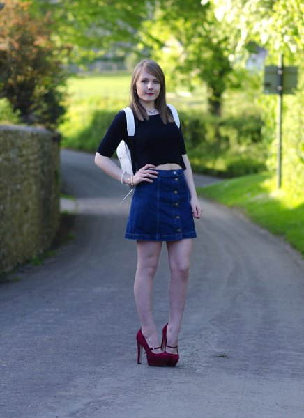 black crop top with half sleeves and a blue, flared denim skirt