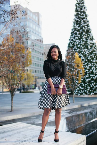 black knitted sweater with half sleeves and checked midi skirt