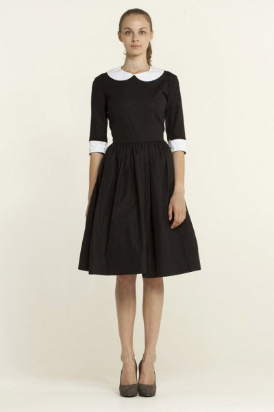 black, half-sleeved, flared mini dress with round collar
