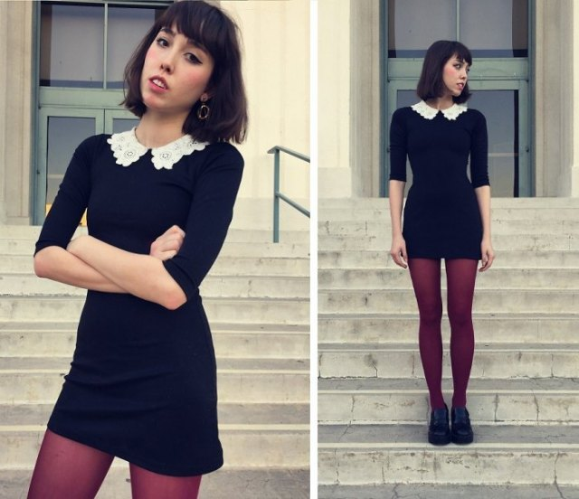 black dress with scalloped collar and stockings and oxford shoes
