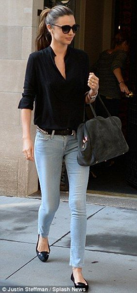 black short sleeve shirt with light blue skinny jeans and flats