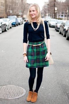 black t-shirt with half sleeves and green and dark blue checked mini skirt