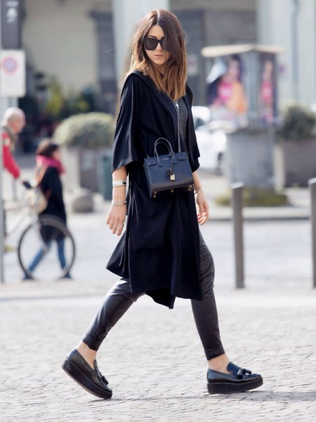 black trench coat with half sleeves, leather gaiters and slippers