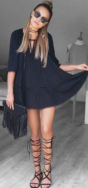 black tunic dress with half sleeves and gladiator sandals
