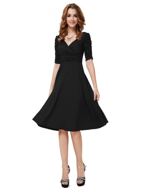Black, half-sleeved V-neck fit and knee-length cocktail dress with flare