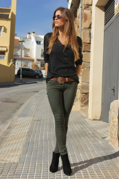 black t-shirt with V-neck and dark olive green drainpipe trousers