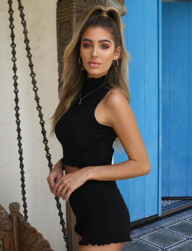 black top with halter neckline and high-waisted knitted shorts with serrated edge