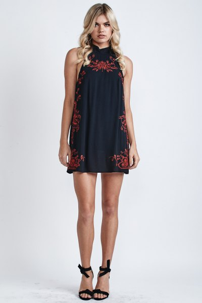 black halter neck mini dress with red embroidery