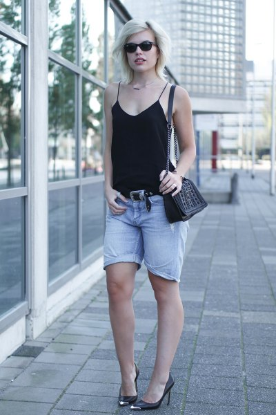 black halter top with light blue baggy denim shorts