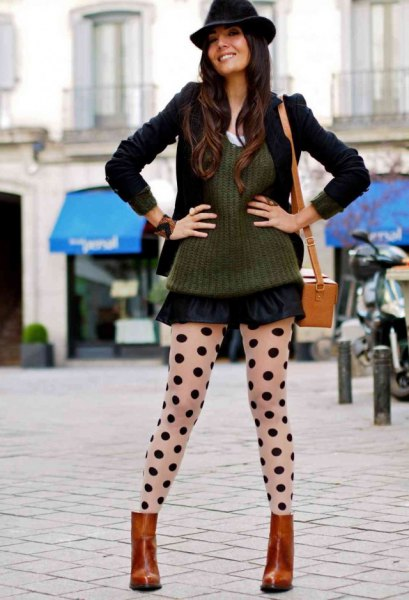 black hat with green ribbed sweater and minirater skirt