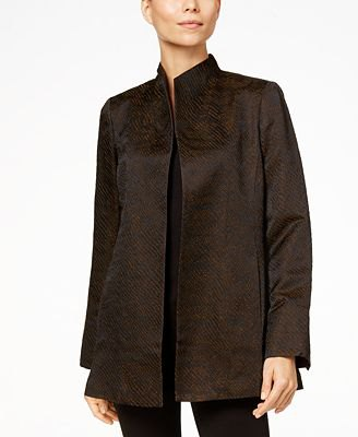 black silk jacket with high collar, t-shirt and skinny jeans