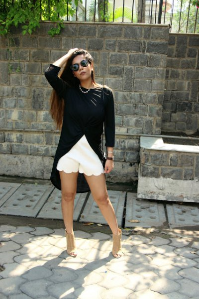 black high low top white shorts with scalloped hem