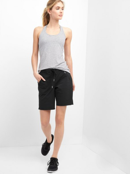 black hiking shorts with a striped vest top
