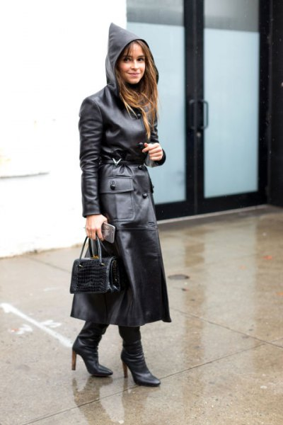 black trench coat made of maxi leather with hood and boots with heel