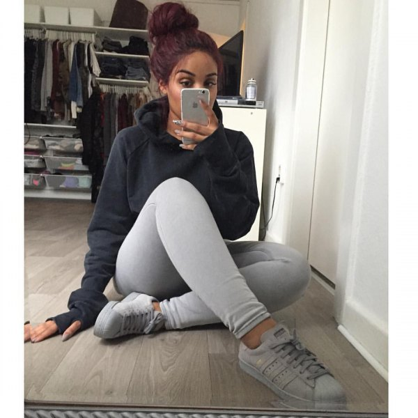 black hoodie with light gray leggings and white sneakers