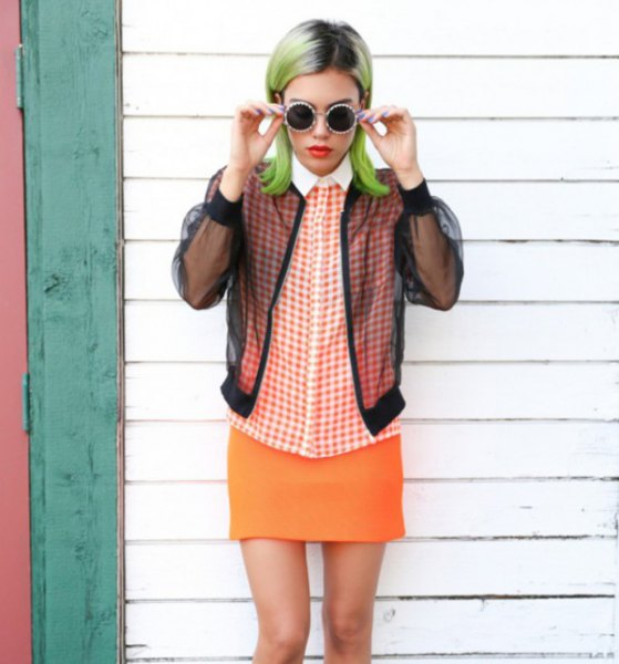 black jacket with checked shirt and orange skirt
