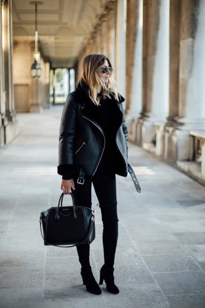 black jacket with skinny jeans and boots with ankle heel