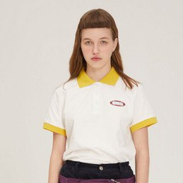 black jeans and white polo shirt with yellow collar