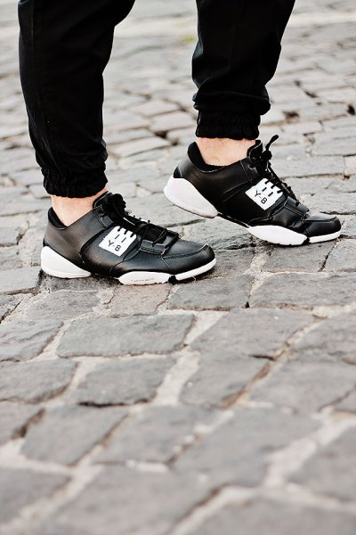 black jogger pants with leather running shoes