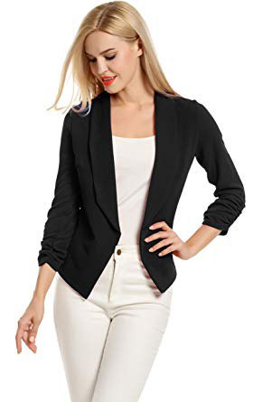 black knitted blazer with white top with a scoop neckline and matching skinny jeans