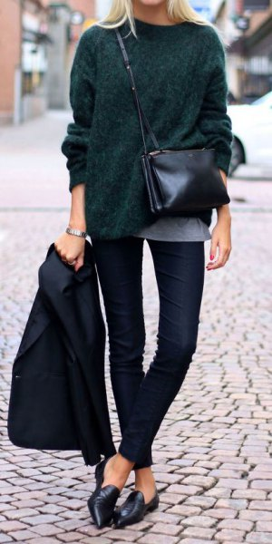 black, coarsely knitted sweater with dark jeans and leather loafers