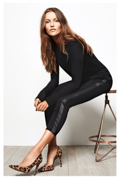black, figure-hugging knitted sweater with short drainpipe trousers