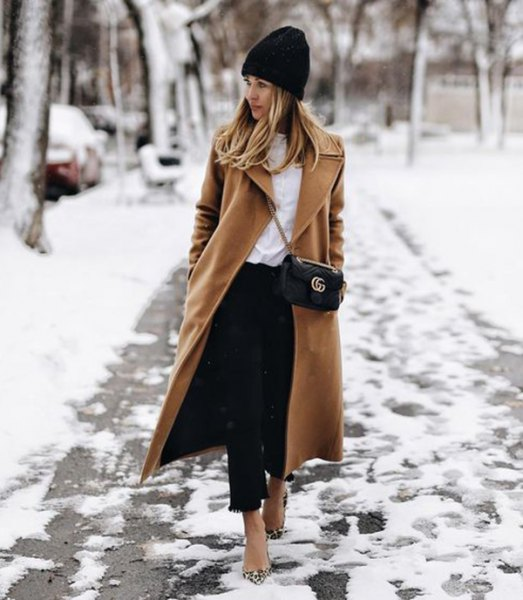 black knitted hat with camel maxi wool coat and short jeans
