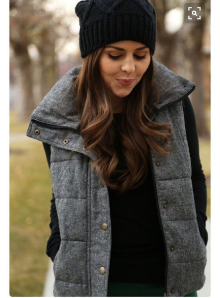 black knitted hat with sweater with thick vest